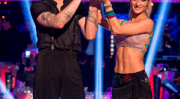 Strictly champions Aliona Vilani and Jay McGuiness with their trophy