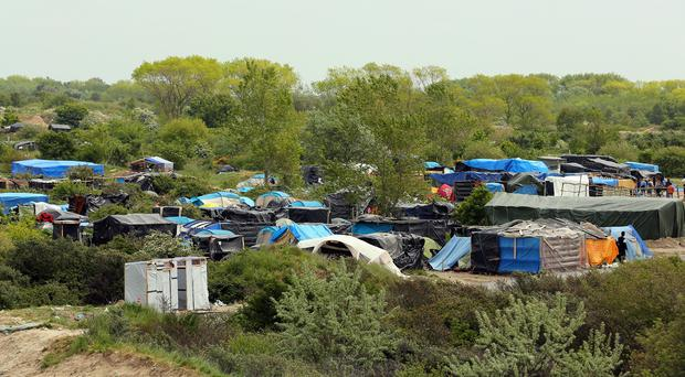 The camp in Calais is home to some 6,000 migrants in makeshift accommodation and tents