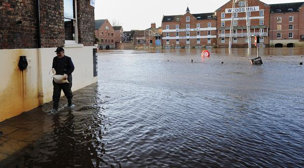 The River Ouse in York continues to rise flooding riverside properties in the city centre