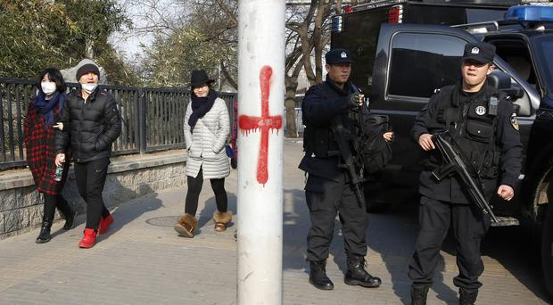 Heavily armed police officers near Sanlitun in Beijing after the US and British embassies warned of possible threats against westerners (AP)