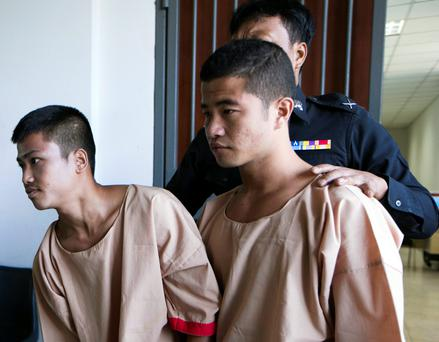 Wai Phyo (right) and Zaw Lin are escorted by officials after their guilty verdict