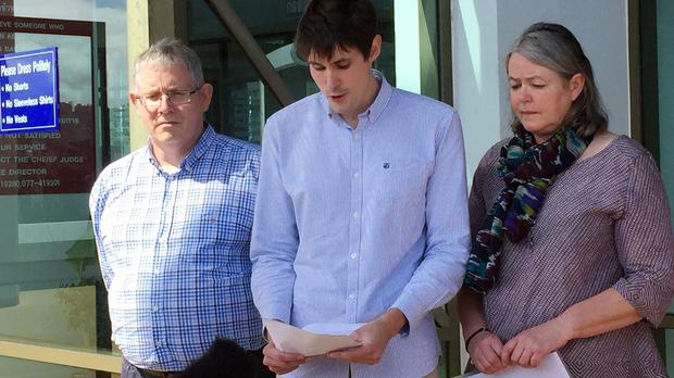 Michael Miller, flanked by his parents Ian and Sue, speaks outside Koh Samui provincial court after two men were sentenced to death for the murder of his brother, David, and Hannah Witheridge in Koh Tao, Thailand, in September last year.