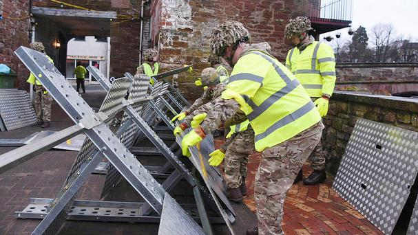Soldiers helping to set up flood defences in Appleby as the Army was called in to support efforts to protect flood-hit areas of Cumbria (Ministry of Defence/PA)