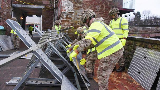 Soldiers helping to set up flood defences in Appleby as the Army was called in to help protect flood-hit areas of Cumbria (Ministry of Defence/PA)