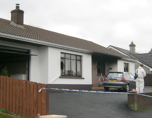 Police and forensics staff at the scene of the house fire at Silverhill Park in Enniskillen, Co Fermanagh