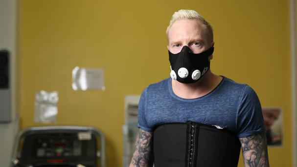 Ex-Olympian Iwan Thomas wears resistance breathing apparatus that creates the experience of Chronic Obstructive Pulmonary Disease (COPD)