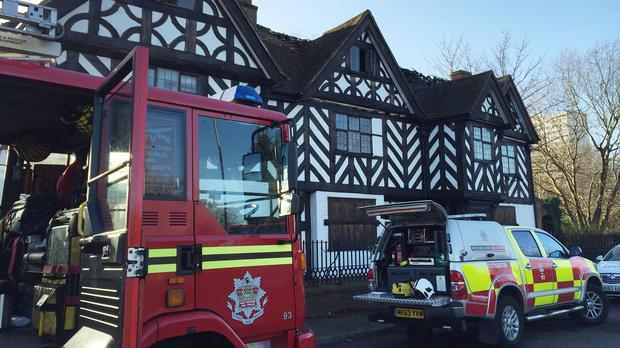 Fire crews outside the 17th century Stratford House building in Birmingham following a fire on the first floor