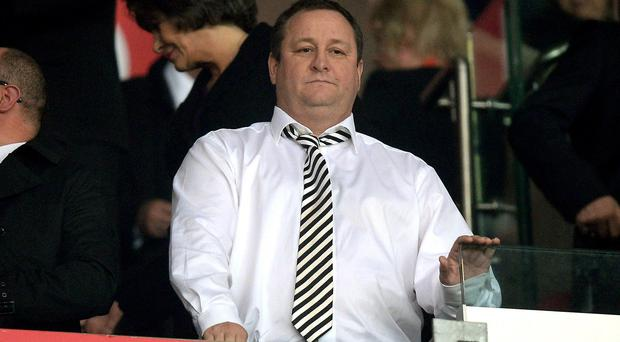 Sports Direct's Mike Ashley says the company will spend £10 million to make sure employees earn above the minimum wage
