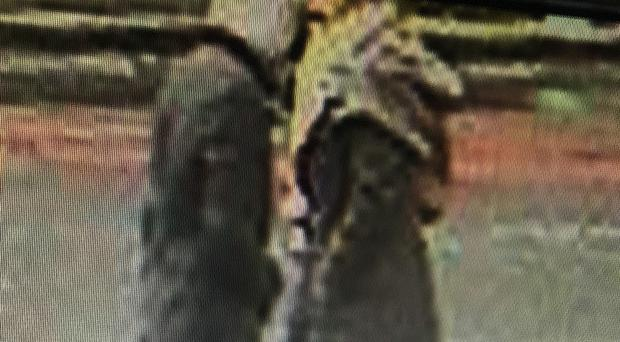 CCTV still of a man police wish to speak to after a widow had her handbag snatched while she was cleaning her late husband's grave on Christmas Eve (Metropolitan Police/PA)