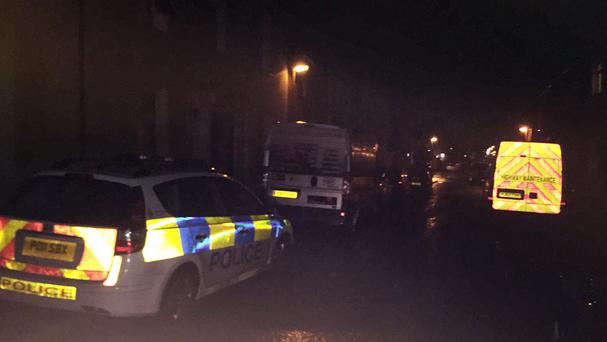Police at the scene in Dundonald Street in Preston, Lancashire, where a 22-year-old man was bitten and killed by a dog