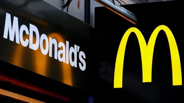 Shots were fired at a vehicle in a McDonald's restaurant car park