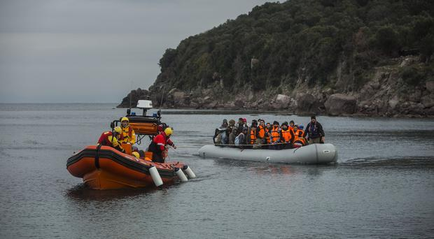 A dinghy with refugees and migrants on board arrives at the Greek island of Lesbos (AP)