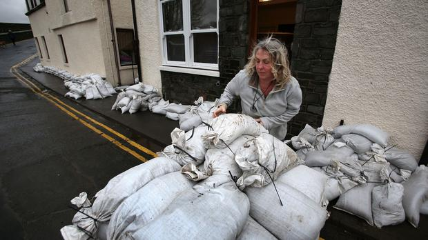 People in Peebles in the Scottish Borders try to clear up as forecasters warned of more persistent rain