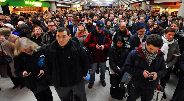 File photo dated 30/10/10 of passengers waiting after delays to train services, as consumer group Which? has launched a
