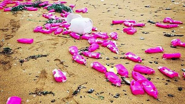 Thousands of bright pink plastic bottles have washed up on Poldhu beach (Instagram/Poldhu Beach Caf/PA)