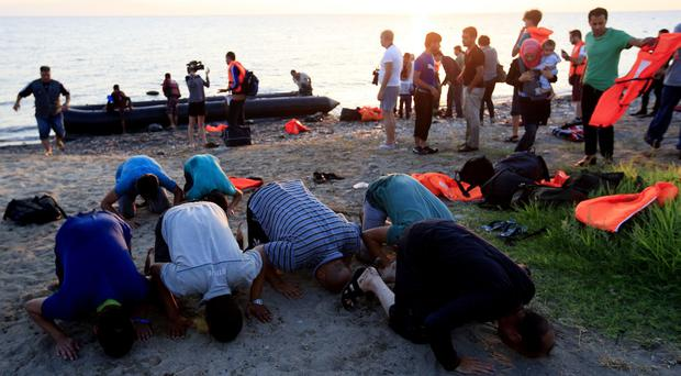 Migrants on a Greek beach, as figures show the number of people seeking asylum in the UK in October was the highest for any month since current records began in January 2009