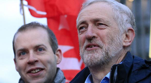 Jeremy Corbyn, right, with former shadow rail minister Jonathan Reynolds during a protest over rail fares