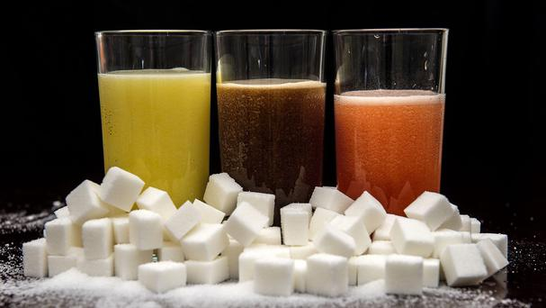 Cancer Research UK has called for a tax on sugary drinks in a bid to curb rising rates of cancer caused by people being overweight