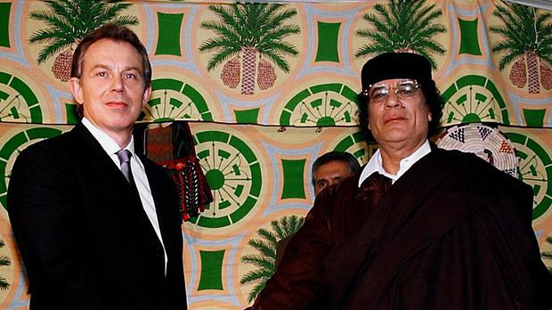 Tony Blair and Muammar Gaddafi shake hands ahead of talks in Tripoli in 2004