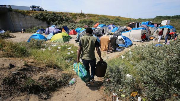Migrants live in squalid conditions in The Jungle camp in Calais