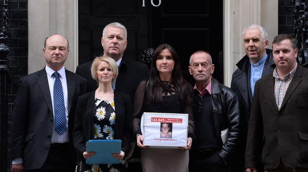 Yvonne McHugh, centre, the girlfriend of Billy Irving, and other family members of the six ex-servicemen handed in a petition to Downing Street