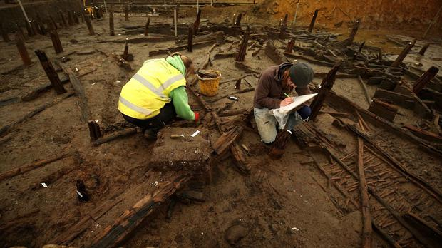 Archaeologists work on the site of a Bronze Age settlement destroyed in a fire 3,000 years ago at Must Farm quarry in Cambridgeshire