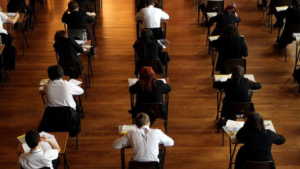 The Education Minister has been urged to rethink his decision to stick with letter grades for GCSEs after two English exam boards pulled out of Northern Ireland
