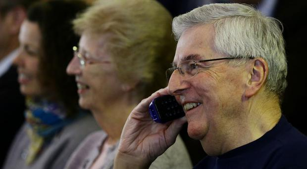 Nigel Peake, father of British astronaut Tim Peake, speaks to him on the telephone earlier in his mission to the ISS