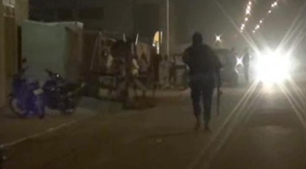 Police near the Splendid Hotel in Ouagadougou, Burkina Faso, which was attacked by al Qaida fighters (AP Television/AP)