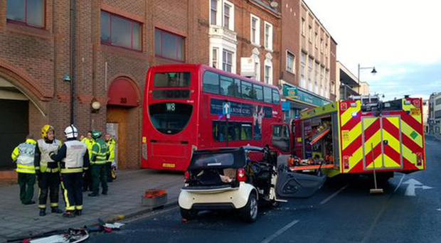 Emergency services attend a crash involving a smart car and a double-decker bus which mounted a kerb in London Road, Enfield (PA/London Ambulance Service)