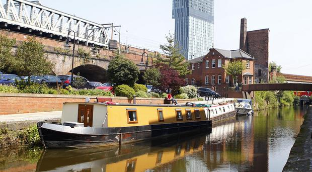 The Manchester Ship Canal beneath the city's Beetham Tower skyscraper