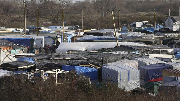 A court ruled four young Syrians should immediately be brought to Britain from the 'Jungle' refugee camp in Calais
