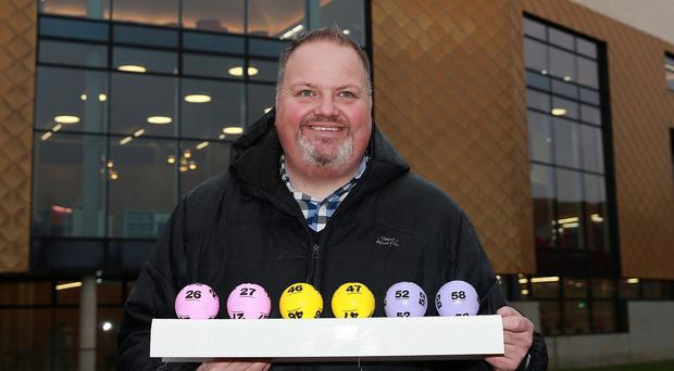 Andy Carter, Senior Winners' Advisor at The National Lottery, outside The Hive in Worcester
