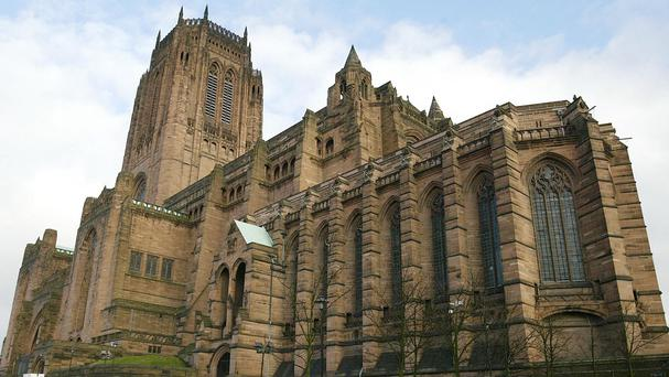 A man kicked a boy in a 'racially aggravated assault' in a service at Liverpool Cathedral, police said