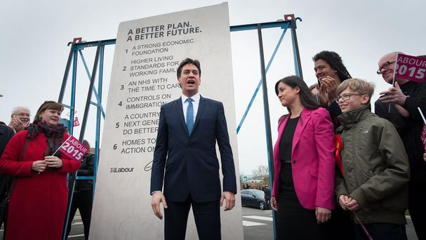 Former Labour leader Ed Miliband unveiling his party's pledges carved into a stone plinth known as the