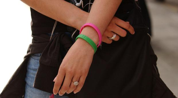 The use of wristbands to identify asylum seekers has been condemned by campaigners