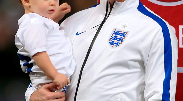 Family man: Rooney with his sons Kai and Klay