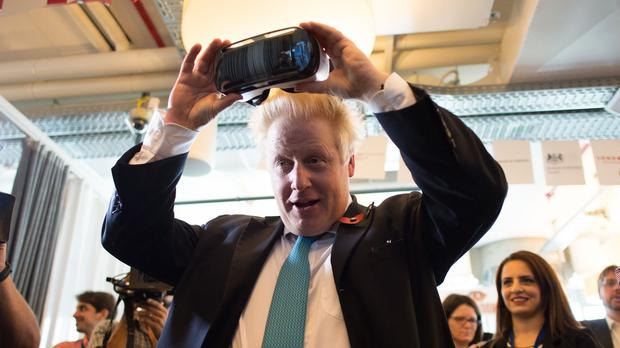 Boris Johnson trying on a virtual reality headset at Google's Tel Aviv offices - he said such corporate giants should pay more tax