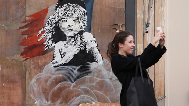 A new artwork by Banksy, depicting the girl from Les Misérables affected by tear gas, opposite the French embassy in Knightsbridge, London.