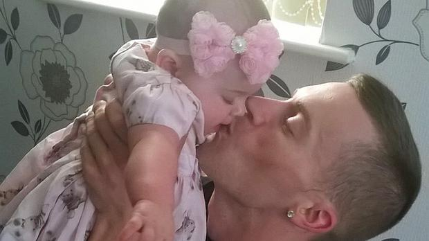 M1 wrong-way crash victim Michael Luciw, 27, from Nottingham, with his daughter Elise (Leicestershire Police/PA)