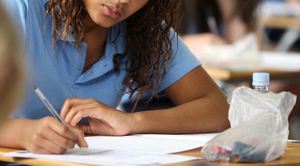 File photo dated 13/06/08 of a pupil after an exam as many headteachers are against a government move which will require all teenagers to take GCSEs in traditional academic subjects, a survey by the Association of School and College Leaders (ASCL) found.