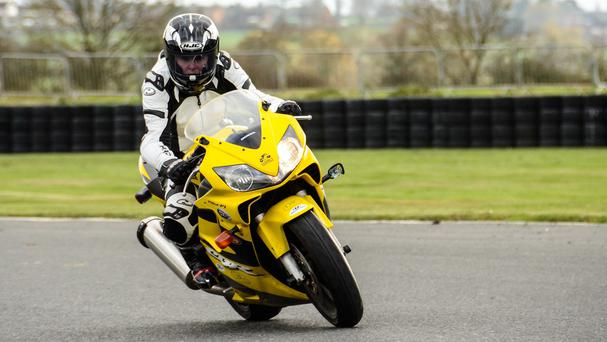 Claire Lomas, a former horse rider who was paralysed following an accident, riding a Honda 600CBR bike at Mallory Park in Leicestershire (Dave Hughes Photography/PA)