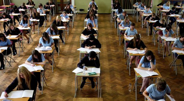 Pupils sit a GCSE English exam at Colchester County High School for Girls