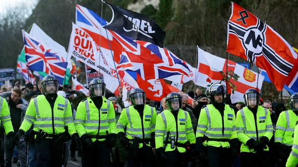 Right-wing protesters escorted by police at Dover