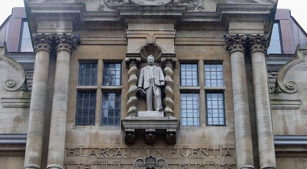 The statue can be seen on the front of Oriel College