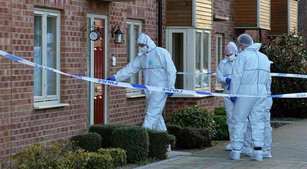Police forensic officers at a home in Beeston Way, Allerton Bywater near Leeds, after a woman and two children were found dead