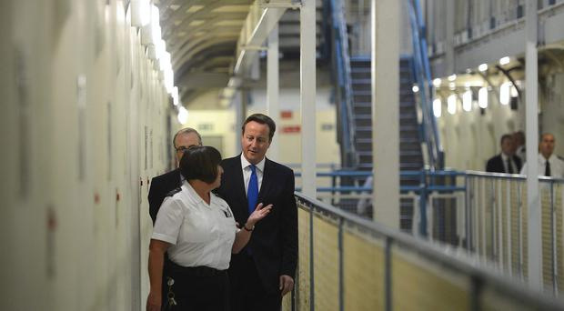 David Cameron pictured on a visit to a prison