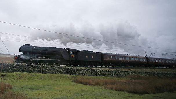 The Flying Scotsman leaves Tebay in Cumbria as it hauls the Winter Cumbrian Mountain Express