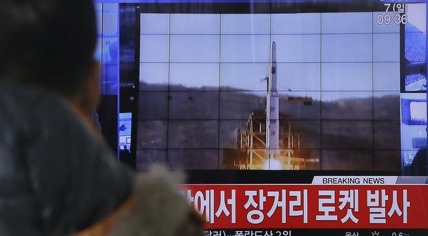 A South Korean TV news programme with file footage about North Korea's rocket launch (AP)
