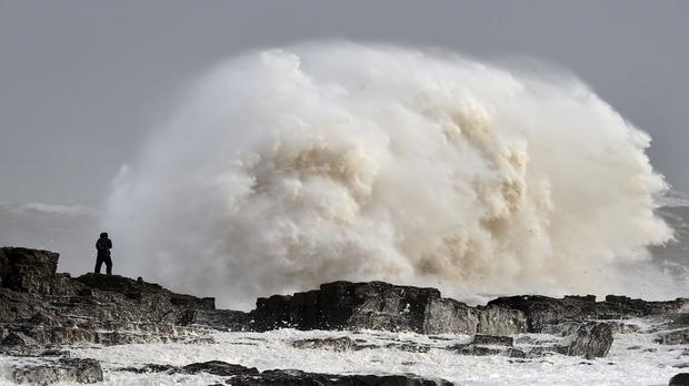 Winds of nearly 100mph battered Britain after Storm Imogen slammed into the south coast bringing fierce gusts and torrential downpours.